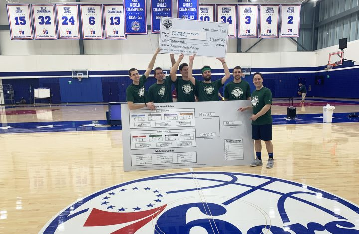 NFI champions of ARCO Charity Basketball Tournament at 76ers Training Facility, holding bracket & check to PYB