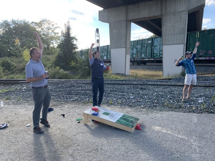 Playing cornhole at Bags & Brews event
